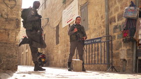 Israeli soldiers guarding one of the main street in old city stock video