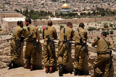 Israeli soldiers in Jerusalem. EAST JERUSALEM, OCCUPIED PALESTINIAN TERRITORIES - JUNE 2: Israeli soldiers armed with assault rilfes look out over the Old City Stock Photos