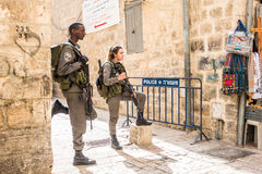 Israeli soldiers - man and woman - guarding Jerusalem Royalty Free Stock Photos
