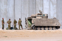 Israeli soldiers outside armed vehicle. NACHAL OZ, ISR - JAN 14 2009:Israeli soldiers outside armed vehicle.IDF is one of Israeli society's most prominent Royalty Free Stock Image