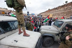 Israeli soldiers at Palestinian protest. Israeli soldiers block the path of Palestinian marchers attempting to block Route 60 near the Al Nashash Junction Stock Photography