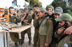Israeli Soldiers Prepared for Ground Incursion in Gaza Strip. NACHAL OZ, ISR - DEC 29:Israeli soldiers having the last call home during the final preparation of Royalty Free Stock Image