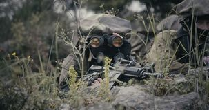 Israeli soldiers in a surveillance and reconnaissance mission using binoculars. Israeli soldiers in a reconnaissance mission using binoculars and reporting to HQ stock video footage