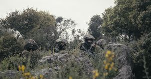 Israeli soldiers in a surveillance and reconnaissance mission using binoculars. Israeli soldiers in a reconnaissance mission using binoculars and reporting to HQ stock footage