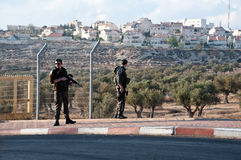Israeli Soldiers and Settlements. BETHLEHEM, OCCUPIED PALESTINIAN TERRITORIES - OCTOBER 26: Israeli soldiers guard a checkpoint at the entrance to Rachel's Tomb Royalty Free Stock Photo