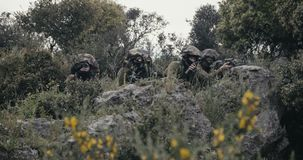 Israeli soldiers in a surveillance and reconnaissance mission using binoculars. Israeli soldiers in a reconnaissance mission using binoculars and reporting to HQ stock video