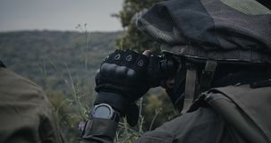 Israeli soldiers in a surveillance and reconnaissance mission using binoculars stock footage