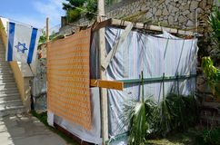Israeli Sukkah. A Jewish decorated Sukkah in with the flag of Israel in its front Stock Images