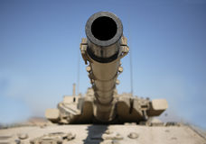 Israeli Tank. A modern Israeli tank - symbol of power, war and security, and of not being bullied. This tank is in razor sharp focus at the shooting end, adding Stock Images