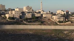 The Israeli West Bank barrier in East Jerusalem stock footage