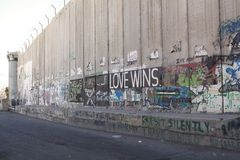 Israeli West Bank barrier. Love wins mural on the Israeli West Bank barrier near Bethlehem, Israel. The Israeli West Bank barrier is a security and separation royalty free stock images