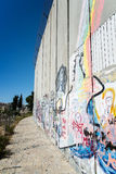 The Israeli West Bank barrier  is a separation barrier. BETHLEHEM, PALESTINE - JUNE 2, 2015: The Israeli West Bank barrier  is a separation barrier. Upon Stock Images