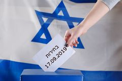 Israeli woman votes at a polling station on election day. Close up of hand. stock images