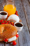 Israelian breakfast background. Beygale, tzfat cheese, ripe cherry tomato, coffee and fresh orange juice - traditional israelian breakfast. Selective focus. Copy Royalty Free Stock Photos