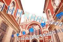 Israelian Flags near synagogue Royalty Free Stock Photos
