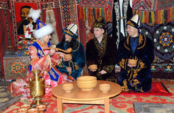 ISS Crewmembers in Baikonur. Expedition 32/33 ISS crew wearing traditional Kazakh clothes with a Kazakh host in Space museum: S.Williams (second from the left) stock photos