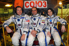 ISS Increment 42-43 Crew Before Launch on Soyuz TMA-15m. Expedition 42-43 ISS crew (L-R: T.Virts, A.Shkaplerov, Samantha Cristoforetti) pose for pictures in Stock Photography