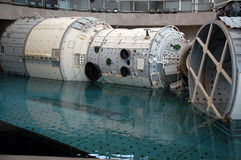 ISS Mockup is Descending. The Russian segment mockup of the International Space Station is descending on the platform at the Russian Hydrolab water immersion Royalty Free Stock Image