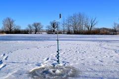 Isskruvar för vinterfiske Arkivbild