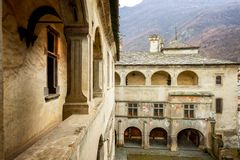 Issogne: Castle of Issogne. The courtyard with the pomegranate fountain. Val D`aosta, Italy royalty free stock image