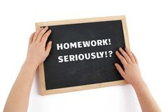 The issue of homework for children depicted with child hands. royalty free stock image