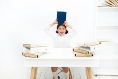 Issues of formal education. Back to school concept. Kid cute tired of studying. Boring lesson. Boring task homework. Get royalty free stock photos
