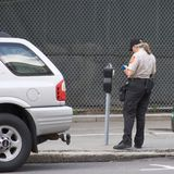 Issuing a Parking Ticket_7916-1S. Meter Maid Issuing a Parking Ticket Stock Image