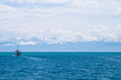 Issyk-Kul. Boat in mountain lake Issyk-Kul located at 1500 meters above sea level Stock Image