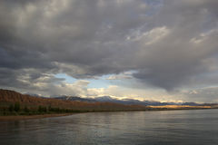 Issyk-Kul lake in the evening. Kyrgyzstan, Central Asia Royalty Free Stock Photo