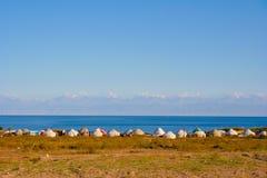 Issyk-Kul. Shore of Lake Issyk-Kul with yurts stock photo