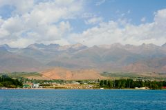 Issyk-Kul. View of the coast of the Issyk-Kul with The sides of the water Royalty Free Stock Photography