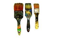 Ist der schwarze schmutzige Malerpinsel drei befleckte Farbe lokalisiert auf weißem Hintergrund Lizenzfreie Stockfotografie