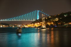Istambul Bosphorus Bridge. Istambul Bosphporus Bridge, connecting Europe and Asia, viewed from small tourist island in the Bosphor pass in the night, Europe end Royalty Free Stock Photography