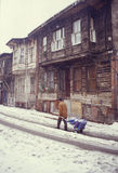 Istanbul. Turkish man dragging a trolley ina snowy street in Istanbul, Turkey Royalty Free Stock Photo