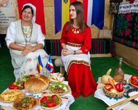 Free Istanbul 4. Etnospor Cultural Festival. Two Women From Moldova And Gagauz Show Their Food In Traditional Dresses Stock Photography - 166568352