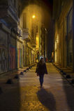 Istanbul, Beyoglu The Streets. Istanbul, Turkey - January 19, 2013: Istanbul, Beyoglu The Streets. A woman walking at night stock photography