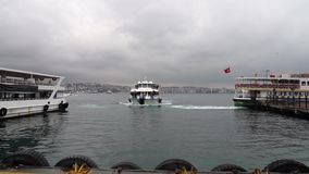 Istanbul boat arriving to pier from Bosphorus on a cloudy and rainy day, Turkey stock video footage