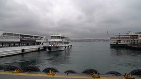 Istanbul boat departing from pier to Bosphorus on a cloudy and rainy day, Turkey stock video footage