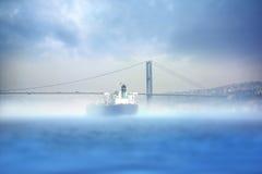 Istanbul Bosphorus Bridge. Bosphorus Bridge and big cargo ship in foggy morning Istanbul stock photos