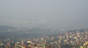 Istanbul Bosphorus Bridge foggy view. Istanbul, Turkey - January 5, 2014: In the morning due to heavy fog suddenly collapsed and continues to impact ferry in Royalty Free Stock Photos