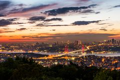 Istanbul Bosphorus Bridge at sunset. 15th July Martyrs Bridge. Night view from Camlica Hill. Istanbul, Turkey royalty free stock images