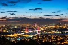 Istanbul Bosphorus Bridge at sunset. 15th July Martyrs Bridge. Night view from Camlica Hill. Istanbul, Turkey stock images