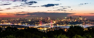 Istanbul Bosphorus Bridge at sunset. 15th July Martyrs Bridge. Night view from Camlica Hill. Istanbul, Turkey royalty free stock photos