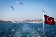 Bosphorus straits ferry view with Turkish flag, Istanbul, Turkey Royalty Free Stock Photo