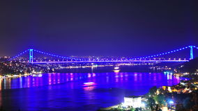 Istanbul Bosporus Bridge Night Time Lapse. The time lapse of Bosporus Bridge with colourful lights at nigh in Istanbul, 4K stock video footage