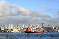Istanbul city. Red cargo ship in Bosporus, Istanbul Stock Image