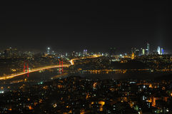 Istanbul city lights and bosphorus bridge Stock Photos