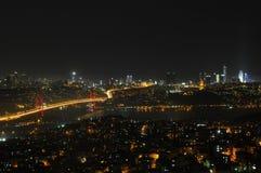 Istanbul city lights and bosphorus bridge Stock Photos