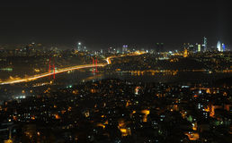 Istanbul city lights and bosphorus bridge Stock Photography