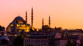 Istanbul cityscape with Suleymaniye mosque with tourist ships floating at Bosphorus at night. Istanbul cityscape with Suleymaniye mosque with tourist ships Royalty Free Stock Photo